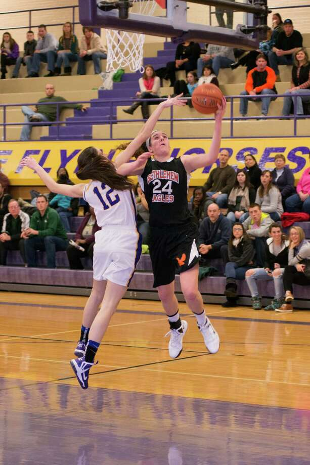 Gabby Giacone of Bethlehem puts up a shot as Courtney Avery of Troy defends on Saturday, Dec. 29, 2012. (Shawn Morgan / Special to the Times Union)