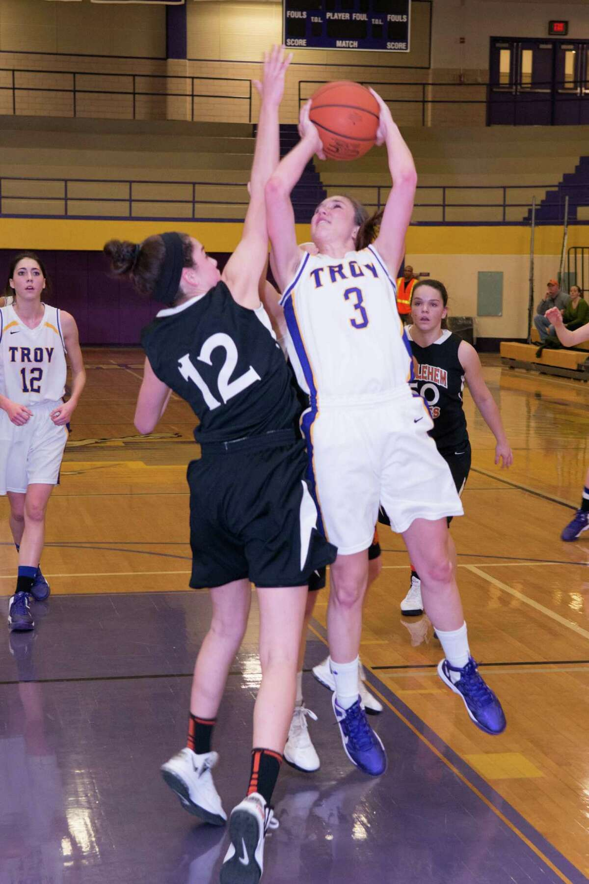 Mary Pattison of Troy shoots over Jenna Giacone of Bethlehem during their game Saturday, Dec. 29, 2012. (Shawn Morgan / Special to the Times Union)
