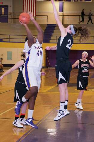 Troy's Cheyenne Williams puts up a shot as Bethlehem's Gabby Giacone defends on Saturday, Dec. 29, 2012. (Shawn Morgan / Special to the Times Union)