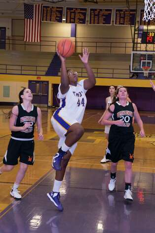 Troy's Cheyenne Williams puts up a shot against Bethlehem on Saturday, Dec. 29, 2012. (Shawn Morgan / Special to the Times Union)