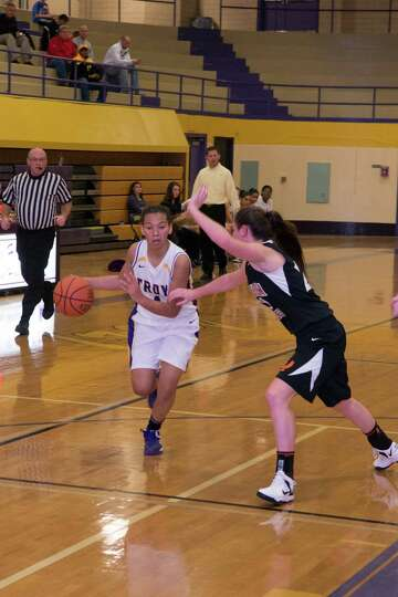 Kiana Patterson of Troy drives against Bridget Murphy of Bethlehem on Saturday, Dec. 29, 2012, in th