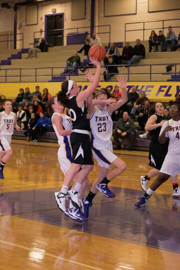 Kaylee Rickert of Bethlehem gets off a shot as Krystyn Knockwood (23) of Troy defends Saturday, Dec.