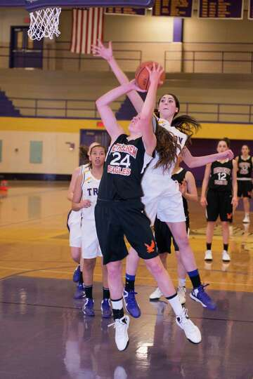 Gabby Giacone puts up a shot against a swarm of Troy defenders on Saturday, Dec. 29, 2012. (Shawn Mo