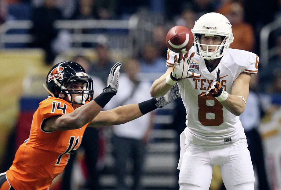 Texas' Jaxon Shipley (08) receives a pass against Oregon State's Jordan Poyer (14) in the second half of the 2012 Valero Alamo Bowl on Saturday, Dec. 29, 2012. Photo: Kin Man Hui, Express-News / © 2012 San Antonio Express-News