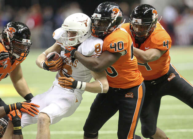 Texas' Jaxon Shipley (08) gets tackled by Oregon State's Michael Doctor (40) and D.J. Alexander (04) in the first half of the 2012 Valero Alamo Bowl on Saturday, Dec. 29, 2012. Photo: Kin Man Hui, Express-News / © 2012 San Antonio Express-News