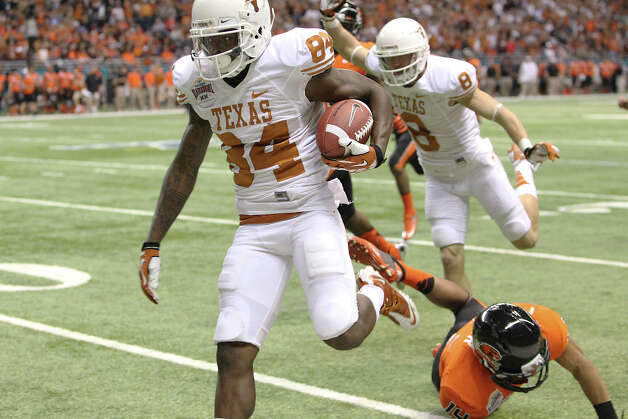 Texas' Marquise Goodwin (84) runs for 64 yards to score a touchdown against Oregon State in the first half of the Valero Alamo Bowl on Saturday, Dec. 29, 2012. Photo: Kin Man Hui, Express-News / © 2012 San Antonio Express-News