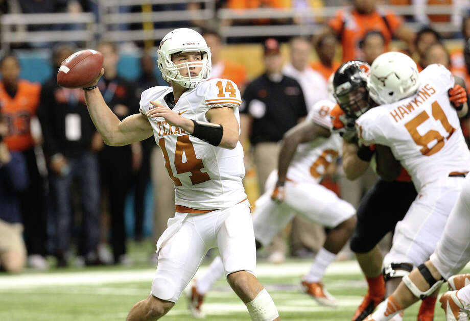 Texas quarterback David Ash drops back for a pass against Oregon State in the first half of the Valero Alamo Bowl on Saturday, Dec. 29, 2012. Photo: Kin Man Hui, Express-News / © 2012 San Antonio Express-News