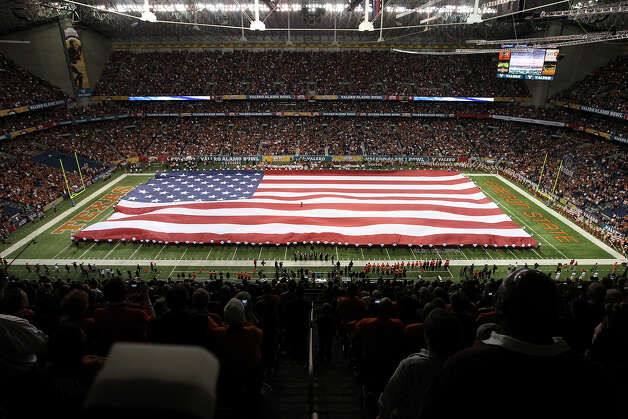 The United States flag is presented during the National Anthem prior to the start of the 2012 Valero Alamo Bowl on Saturday, Dec. 29, 2012. Photo: Kin Man Hui, Express-News / © 2012 San Antonio Express-News
