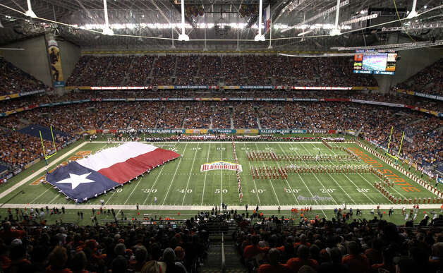 The University of Texas marching band performs on the field prior to the start of the 2012 Valero Alamo Bowl on Saturday, Dec. 29, 2012. Photo: Kin Man Hui, Express-News / © 2012 San Antonio Express-News