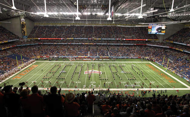 The Oregon State marching band forms the word for the mascot prior to the start of their game against Texas in the 2012 Valero Alamo Bowl on Saturday, Dec. 29, 2012. Photo: Kin Man Hui, Express-News / © 2012 San Antonio Express-News