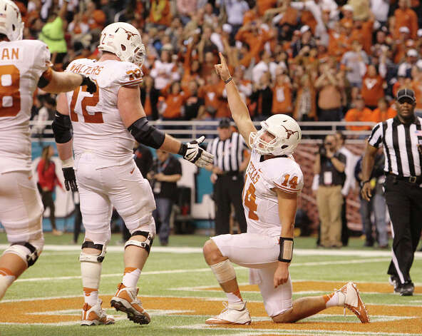 Texas quarterback David Ash (14) gestures after scoring a touchdown against Oregon State in the third quarter of the 2012 Valero Alamo Bowl on Saturday, Dec. 29, 2012. Texas won, 31-27. Photo: Kin Man Hui, Express-News / © 2012 San Antonio Express-News