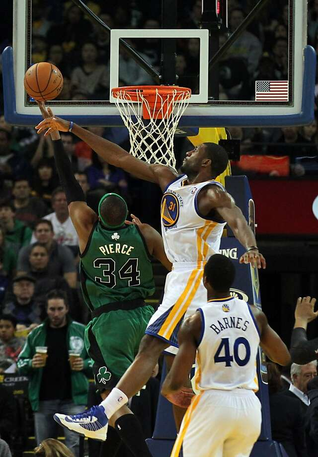 Warriors center Festus Ezeli swats away a shot by the Celtics' Paul Pierce. Ezeli had five of Golden State's 10 blocks. Photo: Lance Iversen, The Chronicle