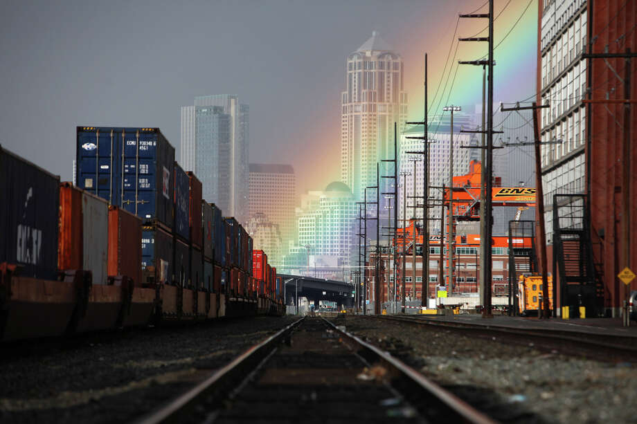 October 23, 2012 — A rainbow makes an appearance in a Sodo railyard during a brief shower in Seattle. Photo: JOSHUA TRUJILLO / SEATTLEPI.COM