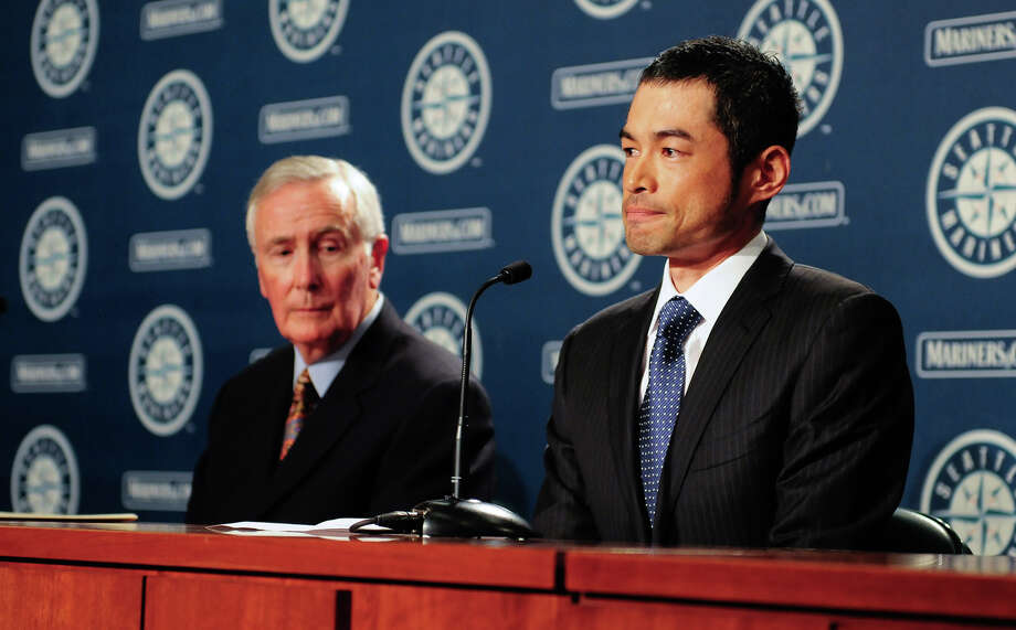 July 23, 2012 — Ichiro Suzuki, right, discusses his trade to the New York Yankees as Mariners CEO Howard Lincoln, left, looks on during a press conference at Safeco Field. Suzuki was traded for right-handed pitchers D.J. Mitchell and Danny Farquhar from the Yankees, ending Ichro's 12-year run with the Mariners. Photo: LINDSEY WASSON / SEATTLEPI.COM