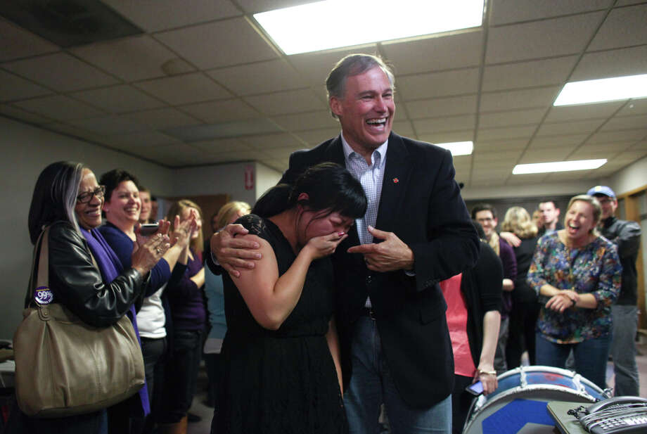 November 9, 2012 — Washington State Governor-elect Jay Inslee hugs outreach director Unjin Lee, the first hire made by his campaign, during a celebration at the Inslee campaign headquarters in Seattle. Inslee secured victory Friday in Washington's race for governor, triumphing over his Republican rival after a grueling campaign that drew more than $40 million in spending. Photo: JOSHUA TRUJILLO / SEATTLEPI.COM