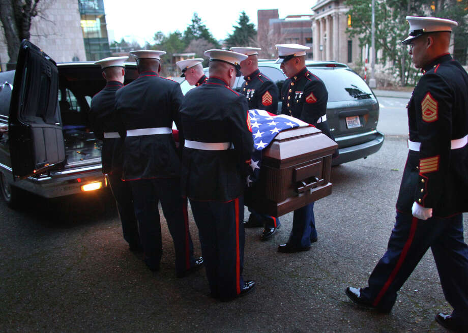 February 11, 2012 — The casket carrying U.S. Marine Sgt. William Stacey is loaded into a hearse after his funeral at the University of Washington in Seattle. Stacey was killed on January 31st in Helmand Province, Afghanistan. Photo: JOSHUA TRUJILLO / SEATTLEPI.COM
