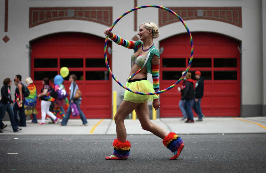 "June 24, 2012 — Evelyn Kennedy marches with a Hula hoop during Seattle's annual Pride Parade. The parade featured tens of thousands of people celebrating a year that included the repeal of the ""don't ask, don't tell"" policy in the U.S. military and same-sex marriage rights in Washington State. Photo: JOSHUA TRUJILLO / SEATTLEPI.COM"