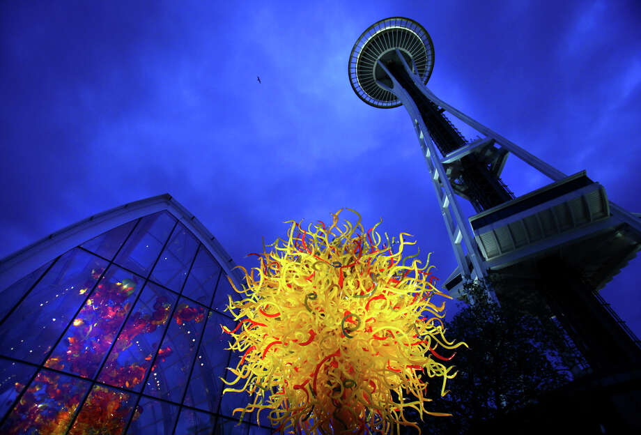 "May 16, 2012 — The Space Needle towers over ""The Sun"" and the Glasshouse, left, at the Dale Chihuly Garden and Glass museum at the Seattle Center, seen during a preview tour. Photo: JOSHUA TRUJILLO / SEATTLEPI.COM"