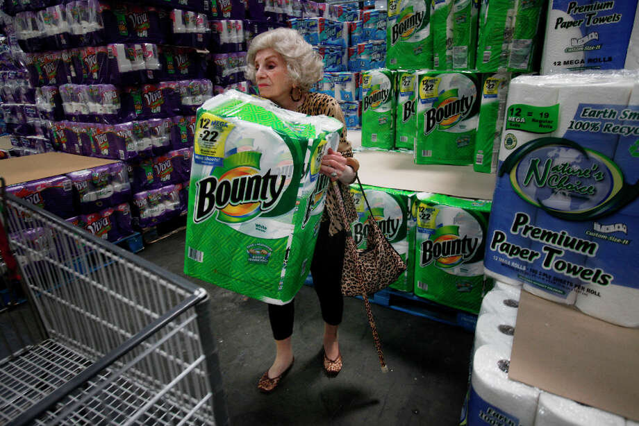 Sally Ann Karmelenski, age 99 in this picture, moves a roll of paper towels to her cart at Costco in 2009. - Karmelenski died at 102 this past September. Photo: Mike Kepka, The Chronicle / SFC