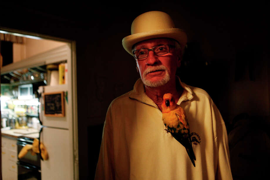 George DuBois a.k.a the Yellow Man of North Beach hangs out in his Grant Avenue apartment in 2009. DuBois died in June this past year. He was 72. Photo: Mike Kepka, The Chronicle / SFC