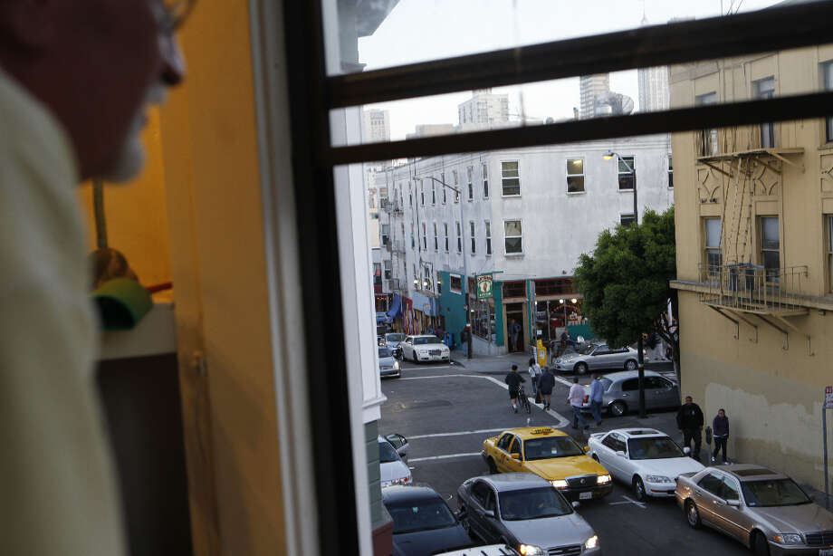 George DuBois a.k.a the Yellow Man of North Beach looks out towards Care Trieste. Photo: Mike Kepka, The Chronicle / SFC