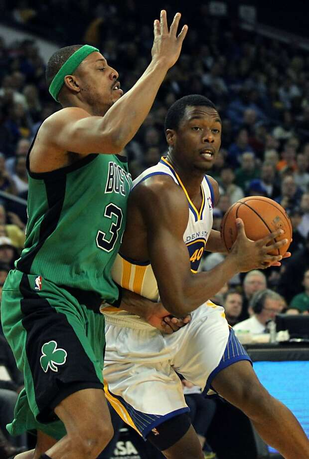 Warriors forward Harrison Barnes drives past the Celtics' Paul Pierce in the first half of their game last month. Photo: Lance Iversen, The Chronicle