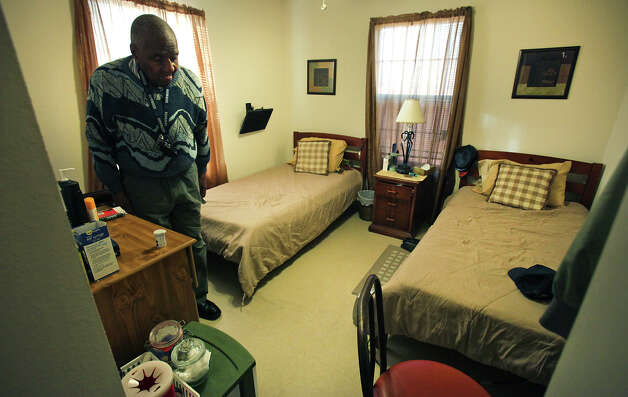 Marion Runnels, 93, in his room at Christian Hope Personal Care Home operated by Gina Ellison, where she cares for 3 clients. Tuesday, Dec. 11, 2012. Photo: Bob Owen, San Antonio Express-News / © 2012 San Antonio Express-News