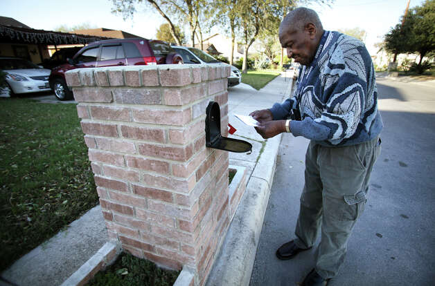 Marion Runnels, 93, a retired postal carrier, always checks the mail at Christian Hope Personal Care Home, operated by Gina Ellison, where she can accomodate 3 clients. Tuesday, Dec. 11, 2012. Photo: Bob Owen, San Antonio Express-News / © 2012 San Antonio Express-News