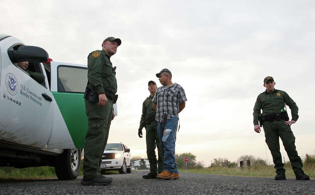 U.S. Border Patrol agents from the Falfurrias, Texas station arrest the driver a pickup truck after a chase that ended on U.S. 281 in near the Brooks and Jim Wells county line, Wednesday, December 19, 2012. The truck was carrying eight people. Apprehensions for the Rio Grande Sector, which includes Falfurrias, have surged by more than 40 percent for comparable 10-month periods in 2011 and 2012. Photo: Jerry Lara, San Antonio Express-News / © 2012 San Antonio Express-News