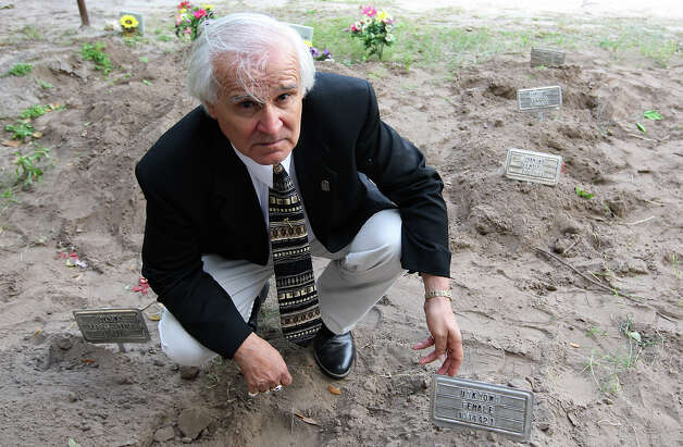 "Brooks County Judge Raul M. Ramirez at the county cemetery in Falfurrias, Texas, Wednesday, December 19, 2012. Ramirez said that with the 127 bodies found in his county this year, the cemetery has run out of spaces for ""John Doe"" burials. Photo: Jerry Lara, San Antonio Express-News / © 2012 San Antonio Express-News"