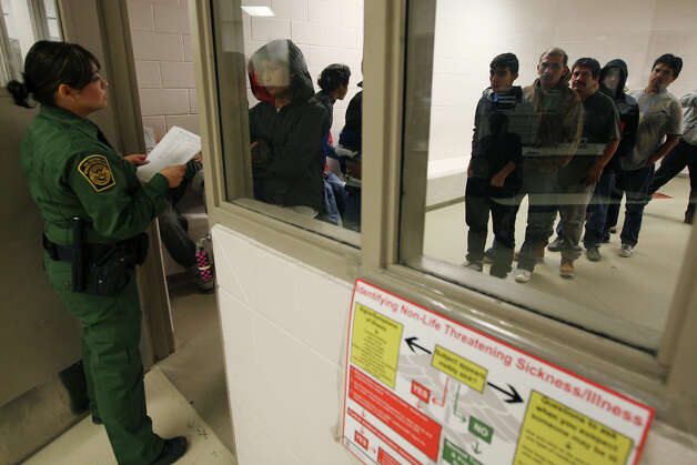 U.S Border Patrol Agent Mari Ramirez lines up immigrants for roll call at the Falfurrias, Texas station, Wednesday, December 19, 2012. Apprehensions for the Rio Grande Sector, which includes Falfurrias, have surged by more than 40 percent for comparable 10-month periods in 2011 and 2012. So far this year, 127 bodies have been found in Brooks County of which Falfurrias is the county seat. Photo: Jerry Lara, San Antonio Express-News / © 2012 San Antonio Express-News