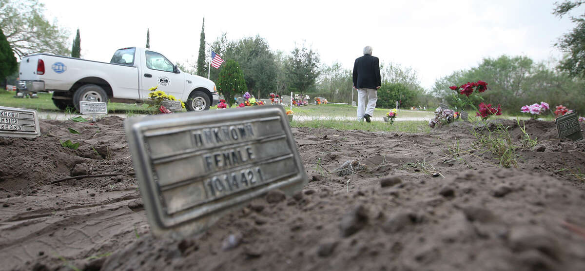 Brooks County Judge Raul M. Ramirez walks around the county cemetery in Falfurrias, Texas, Wednesday, December 19, 2012. Ramirez said that with the 127 bodies found in his county this year, the cemetery has run out of spaces for