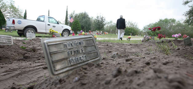 "Brooks County Judge Raul M. Ramirez walks around the county cemetery in Falfurrias, Texas, Wednesday, December 19, 2012. Ramirez said that with the 127 bodies found in his county this year, the cemetery has run out of spaces for ""John Doe"" burials. Photo: Jerry Lara, San Antonio Express-News / © 2012 San Antonio Express-News"