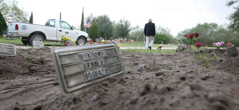 """Brooks County Judge Raul M. Ramirez walks around the county cemetery in Falfurrias, Texas, Wednesday, December 19, 2012. Ramirez said that with the 127 bodies found in his county this year, the cemetery has run out of spaces for """"John Doe"""" burials. Photo: Jerry Lara, San Antonio Express-News / © 2012 San Antonio Express-News"""