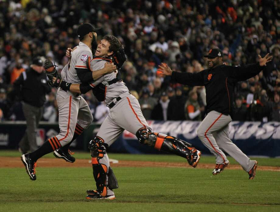 Sergio Romo and Buster Posey celebrate the Giants' Game 4 victory, which completed a four-game sweep of the Detroit Tigers in the 2012 World Series. Photo: Lance Iversen / The Chronicle / ONLINE_YES