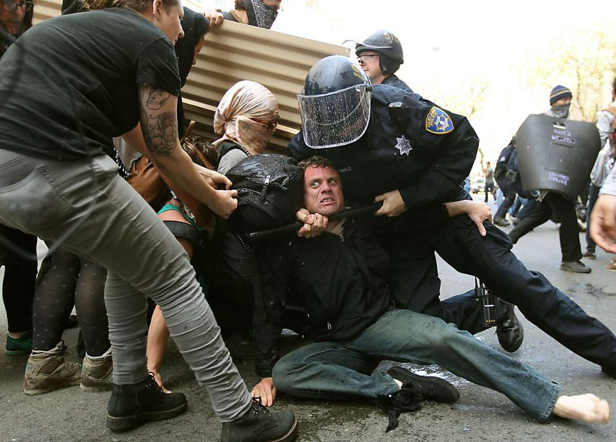Oakland Police place an occupy protester under arrest along Broadway, as they clash in downtown Oakland on Tuesday May 1, 2012, during the May Day general strike.