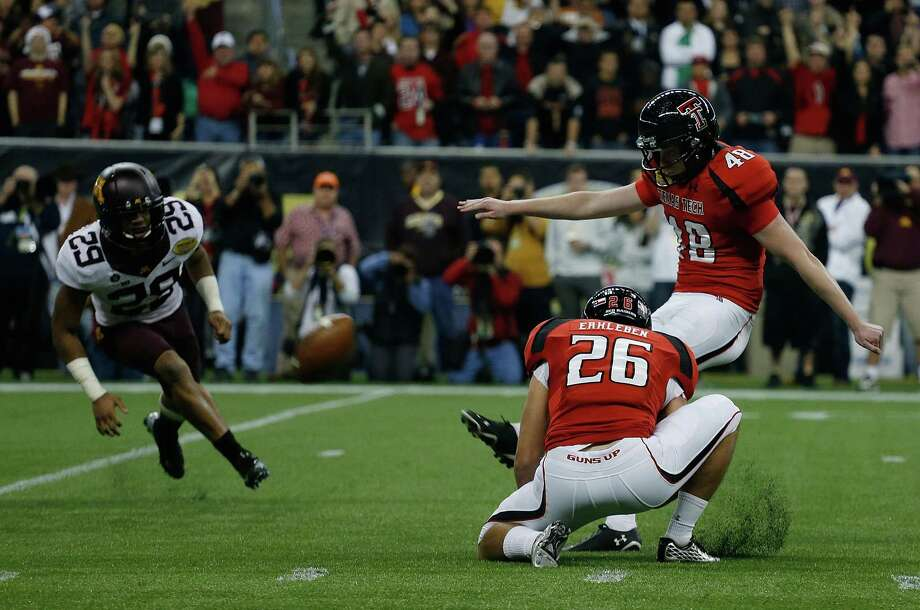 Meineke Car Care of Texas Bowl, Dec. 28: Texas Tech 34, Minnesota 31; Reliant Stadium in Houston; Payout: $1,700,000 PHOTO: Texas Tech's Ryan Bustin (48) kicks a 28-yard field goal to defeat Minnesota during the Meineke Car Care of Texas Bowl. Photo: Scott Halleran, Getty Images / 2012 Getty Images