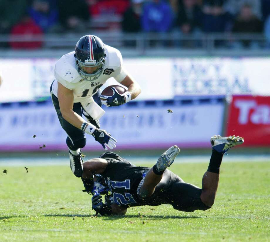 Bell Helicopter Armed Forces Bowl, Dec. 29: Rice 33, Air Force 14; Amon G. Carter Stadium in Fort Worth; Payout: $600,000 PHOTO: Rice's Taylor McHargue (16) dives over the Air Force's Christi Spears (21) during the Armed Forces Bowl. Photo: Cooper Neill, Getty Images / 2012 Getty Images