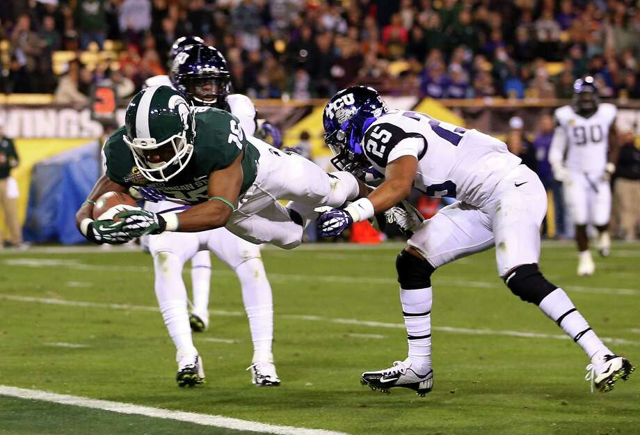 Buffalo Wild Wings Bowl, Dec. 29: Michigan State 17, TCU 16; Sun Devil Stadium in Tempe, Ariz.; Payout: $3,350,000 PHOTO: Michigan State wide receiver Aaron Burbridge (16) dives into the end zone to score a 15-yard touchdown reception past TCU cornerback Kevin White (25) during the thrid quarter of the Buffalo Wild Wings Bowl. Photo: Christian Petersen, Getty Images / 2012 Getty Images