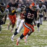 New Era Pinstripe Bowl, Dec. 29: Syracuse 38, West Virginia 14; Yankee Stadium in Bronx, N.Y.; Payout: $1,800,000 PHOTO: Syracuse's Prince-Tyson Gulley (23) runs for a touchdown against West Virginia in the Pinstripe Bowl.