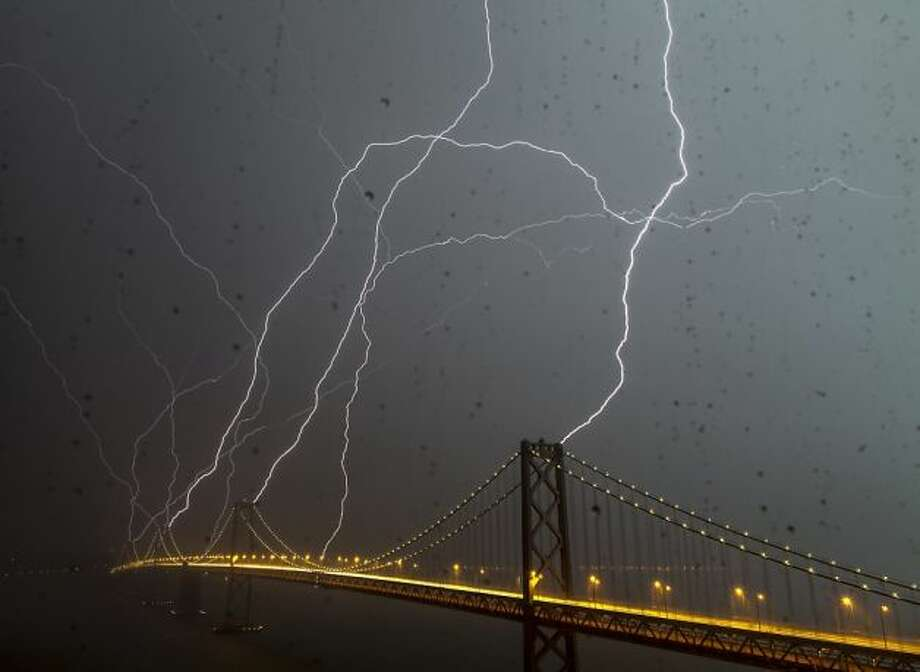 Eight bolts of lightning hit the Bay Bridge during a powerful lightning storm in San Francisco on Thursday, April 12, 2012.  (Phil McGrew / Courtesy)