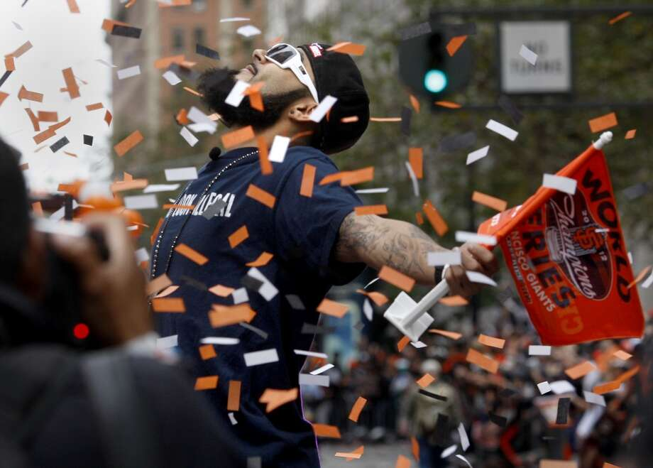 Sergio Romo posed for the crowd as the confetti came down on Market Street. The San Francisco Giants celebrated their second World Series title in three years with a parade down Market Street Wednesday October 31, 2012. (The Chronicle)