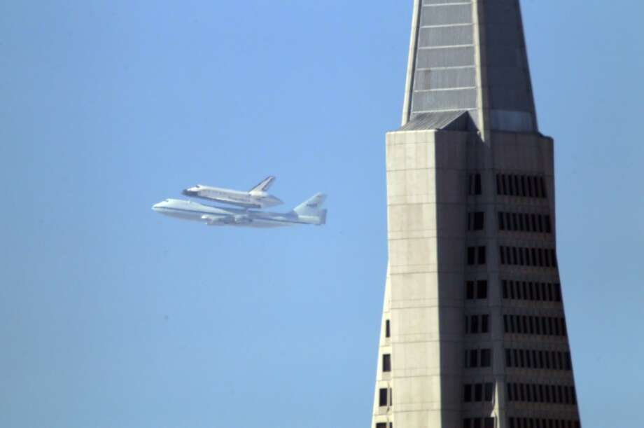 The Space Shuttle Endeavour with the Transamerica Pyramid in the foreground as it flew over the Bay Area on Friday, September 21, 2012, in San Francisco, Calif., on its farewell voyage before it is converted to a museum in Los Angeles. (Carlos Avila Gonzalez / The Chronicle)