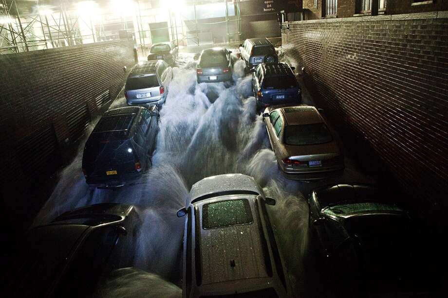 Rising water, caused by Hurricane Sandy, rushes into a subterranean parking garage on October 29, 2012, in the Financial District of New York. (Andrew Burton / Getty Images)