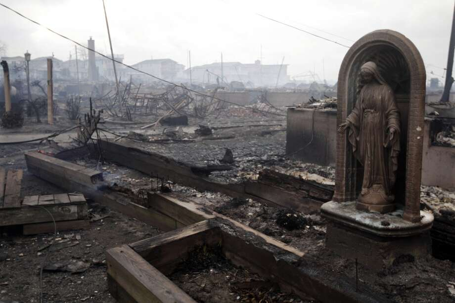 In this Oct. 30, 2012 file photo, damage caused by a fire in the Breezy Point section of the Queens borough of New York is shown. The fire department sent more than 190 firefighters to the blaze caused by superstorm Sandy. (Frank Franklin II / Associated Press)