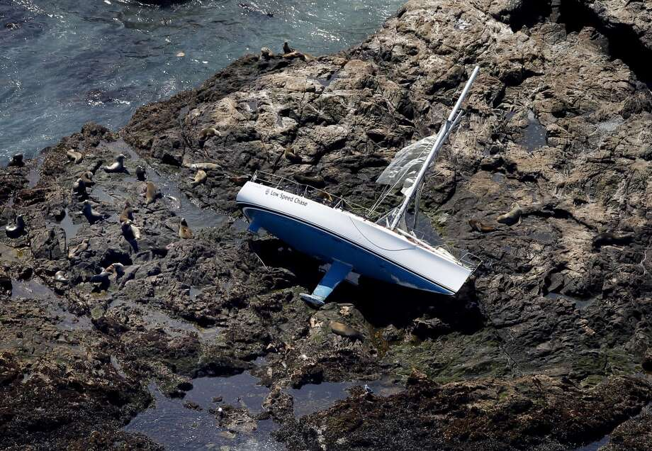 The Low Speed Chase was stranded on rocks on the Farallon islands surrounded by seals and sea lions. The sailing vessel Low Speed Chase lay on its side on the Farallon Islands Monday April 16, 2012.  Five people lost their lives during a race Saturday. (Brant Ward / The Chronicle)