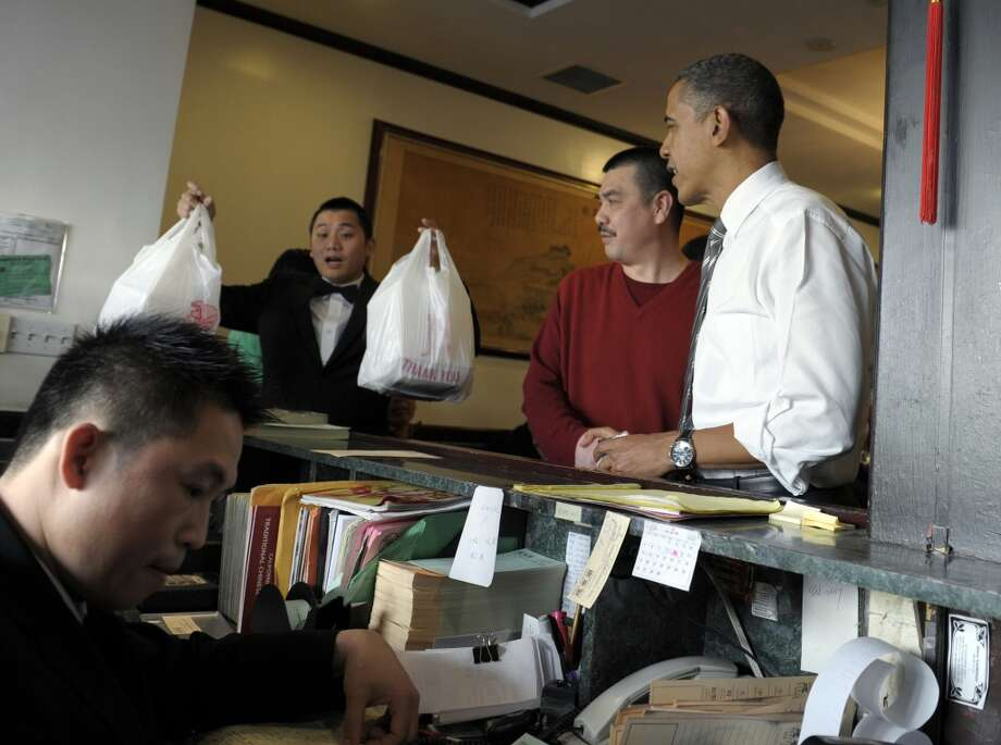President Barack Obama gets his Chinese food from Great Eastern Restaurant in San Francisco, Thursday, Feb. 16, 2012. (Susan Walsh / Associated Press)