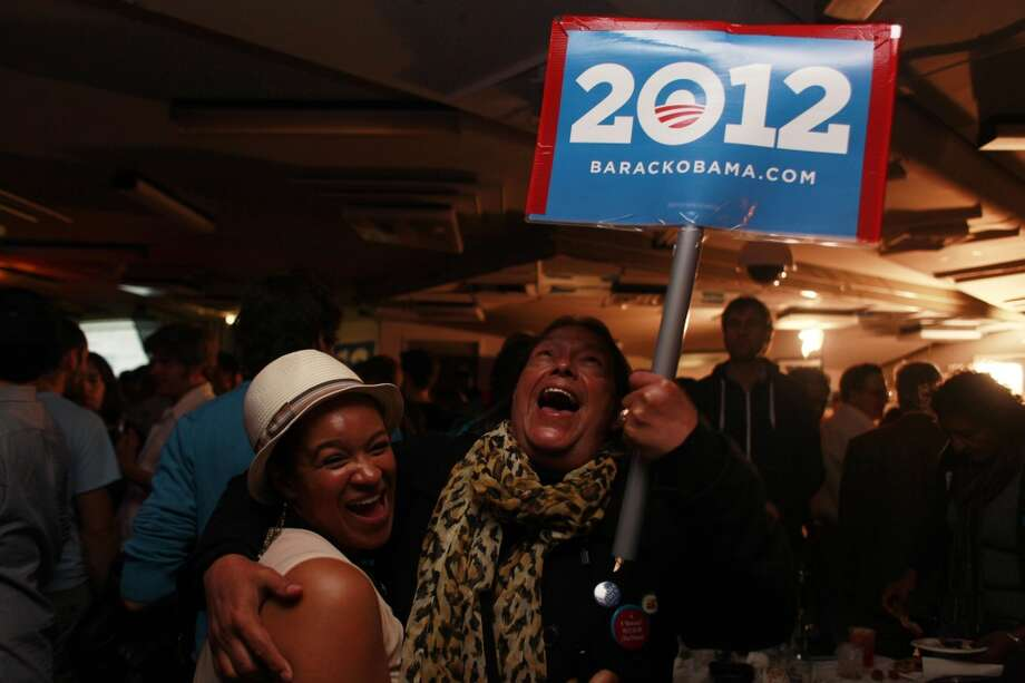 At an election party for the Democratic Party in San Francisco, Gabriel Ortega and Leah Pimentel hug for joy after President Barack Obama wins a second term on Tuesday Nov. 6, 2012 in San Francisco. (The Chronicle)