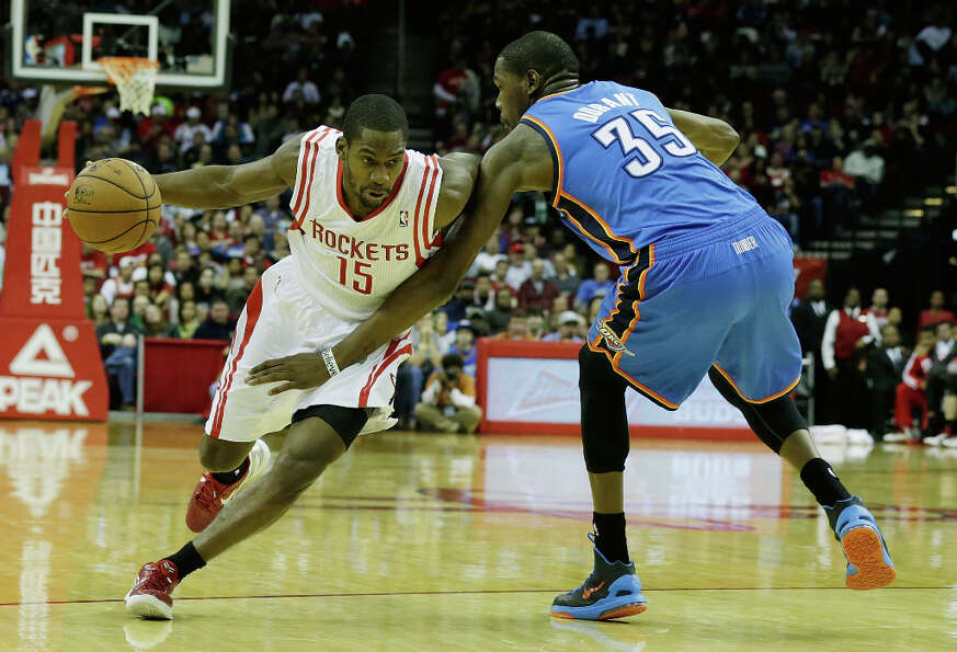 Toney Douglas #15 of the Rockets drives against Kevin Durant.