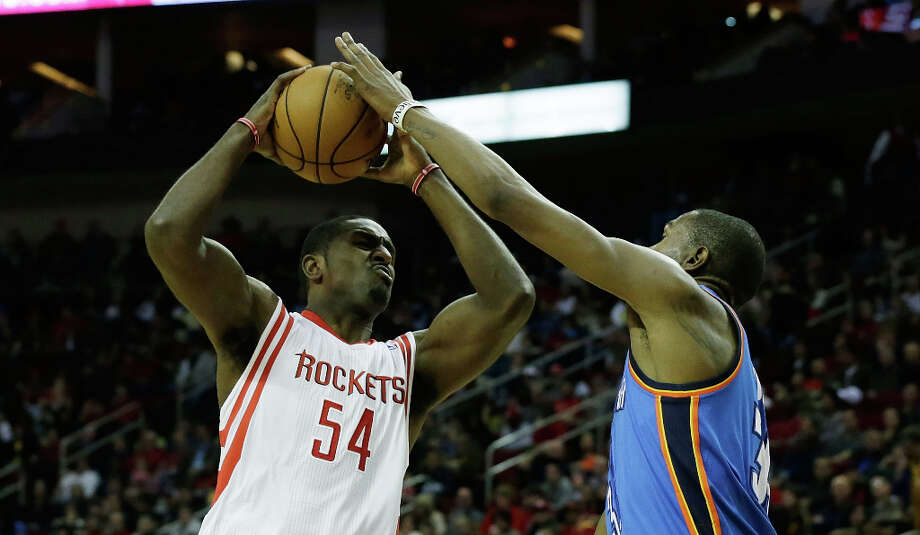 Patrick Patterson #54 of the Rockets takes a shot against Kevin Durant. Photo: Scott Halleran, Getty Images / 2012 Getty Images